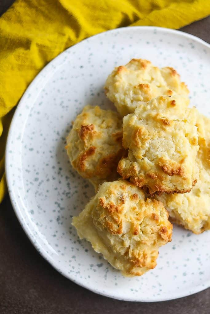 buttermilk biscuits stacked on a white plate