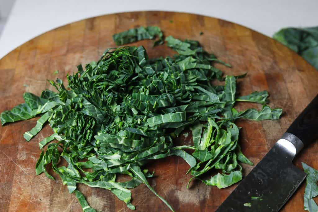 sliced collard green strips on cutting board