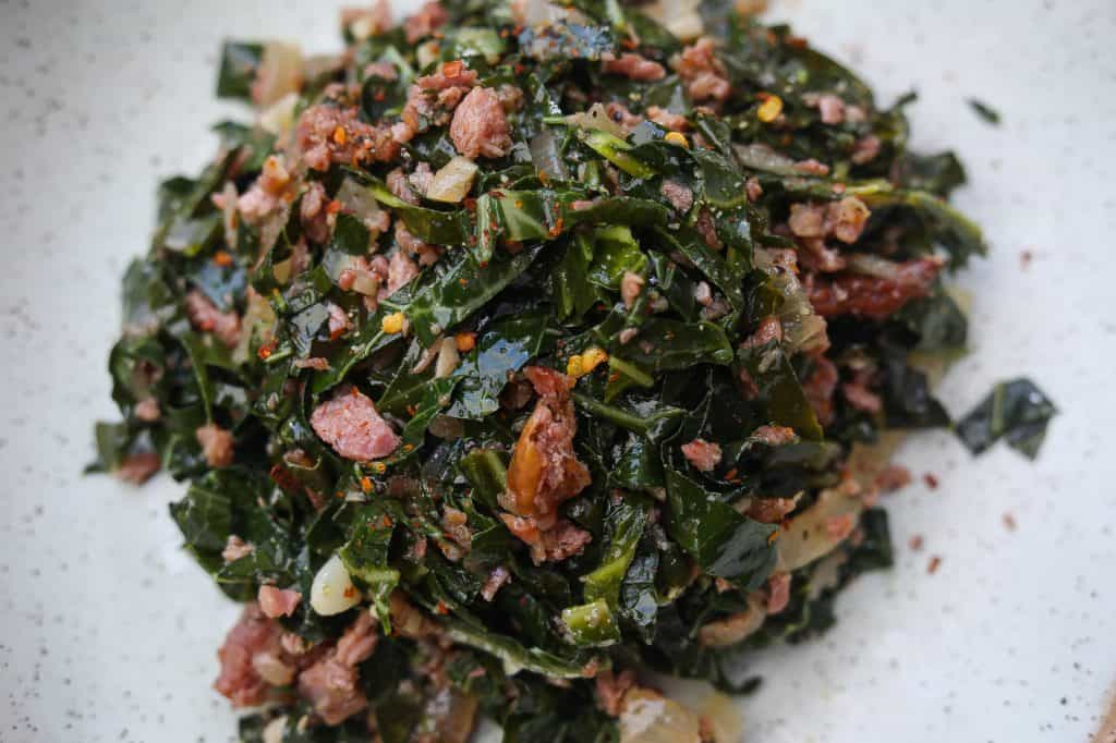 brazilian collard greens and turkey pices on a green plate