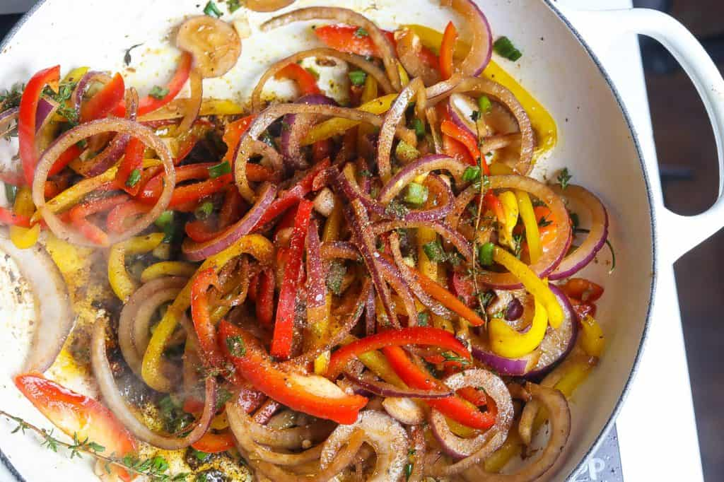 chicken in pan with peppers