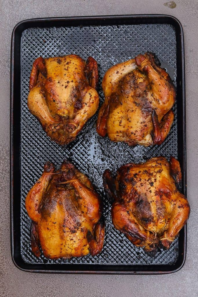 four cornish hens on a tray